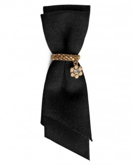 Noeud tissu et cristal - broche noire et dorée